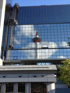 Kyoto Tower, reflected in the station building.